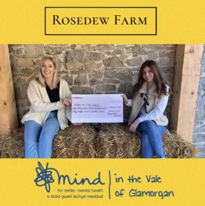 Dellana Davies presenting Menna Jones with a cheque for £1368.14